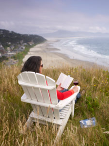 Woman Sitting in an Adirondack Chair