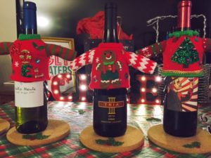 Decorated wine bottles at themed wine tasting party
