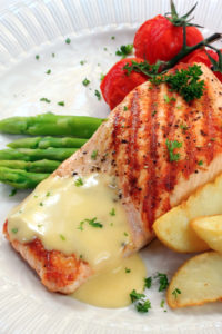 Wine's acidity amplifies the flavor of salmon topped with a rich Hollandaise sauce similar to a squeeze of lemon.