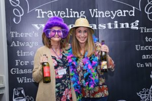 Wine guide leaders wearing fun hats and silly accessories