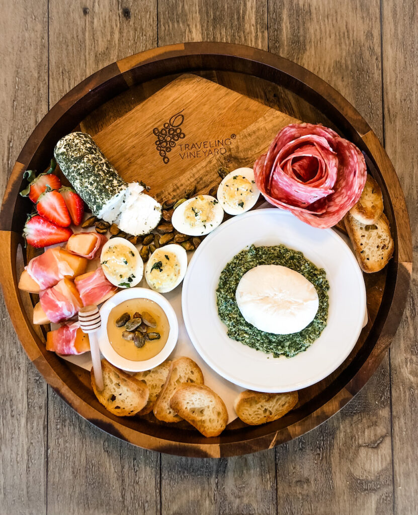 Charcuterie board with in season spring herbs and fruit